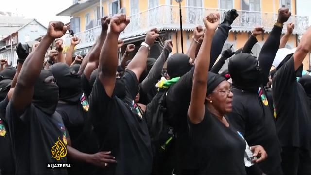 Hundreds of striking protesters in French Guiana have blocked roads and shut down businesses. Two French government ministers are heading to the territory to hear their demands.