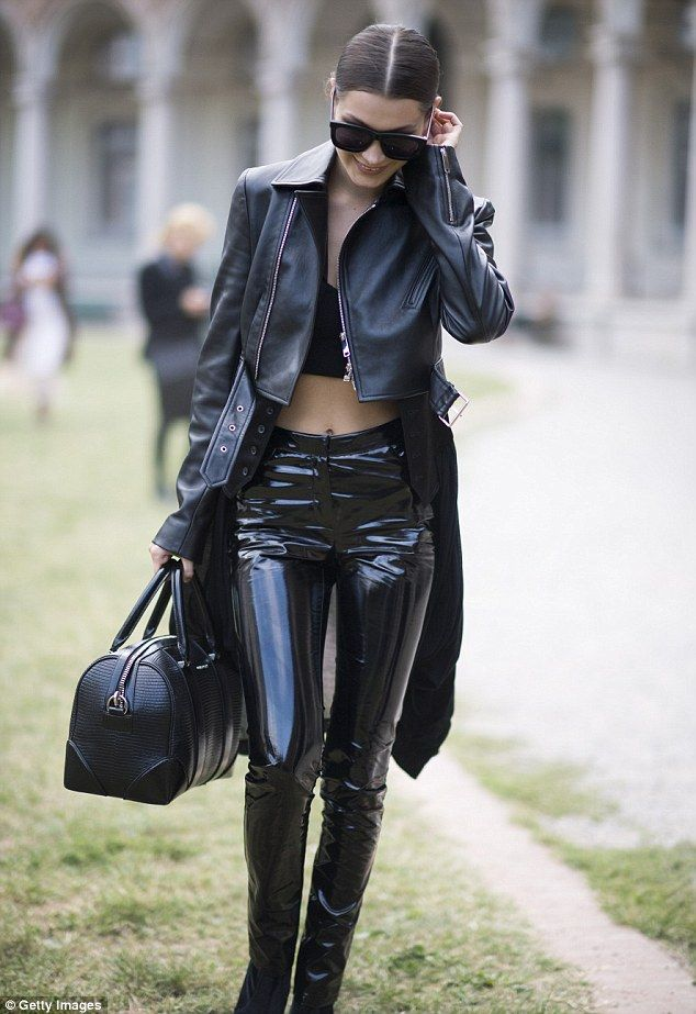Shiny happy people:The 19-year-old sister of fellow supermodel Gigi went for a head-to-toe leather look as she strutted through the Italian streets in her sexy outfit
