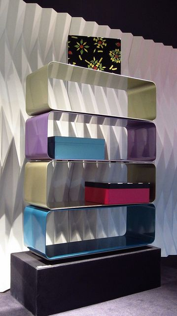 #plisse room divider and #icona boxes design by @Moschino, and #brera bookcase by Marco Piva for #altreforme at Salone del Mobile 2012  #interior #home #decor #homedecor #furniture #aluminium
