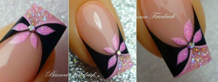 Nude nails with black curved French tips with pink glitter accents and pink glitter flowers nail art