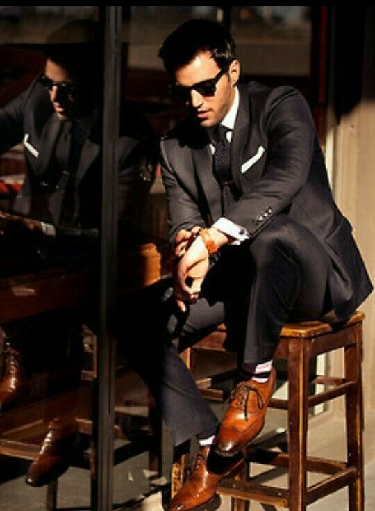 Well suited with nice shoes and an sorted watch.