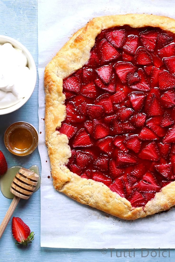 When flaky pie dough rolled out and topped with farm fresh strawberries meets a hot oven, it's nothing short of magic. Sweet and buttery, with jammy strawberry filling and honey whipped cream…