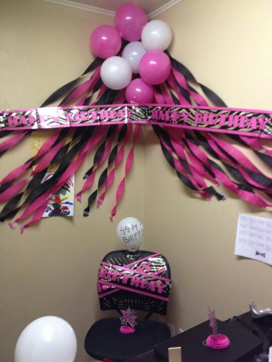 This is the perfect black pink birthday themed corner for 50th birthday decoration ideas for office