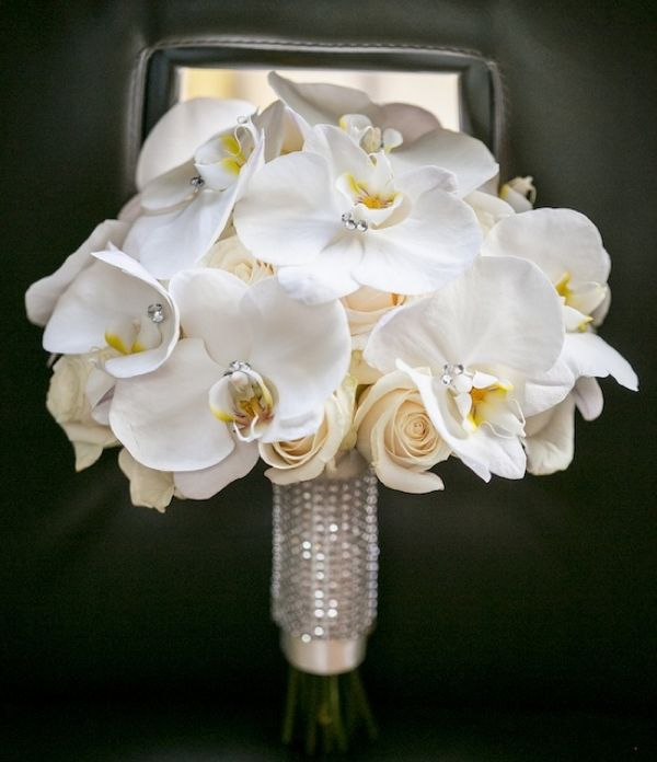orchid and white rose  bouquet like the handle but i wouldnt add the crystals to the orchids like that.  i like the natural look.