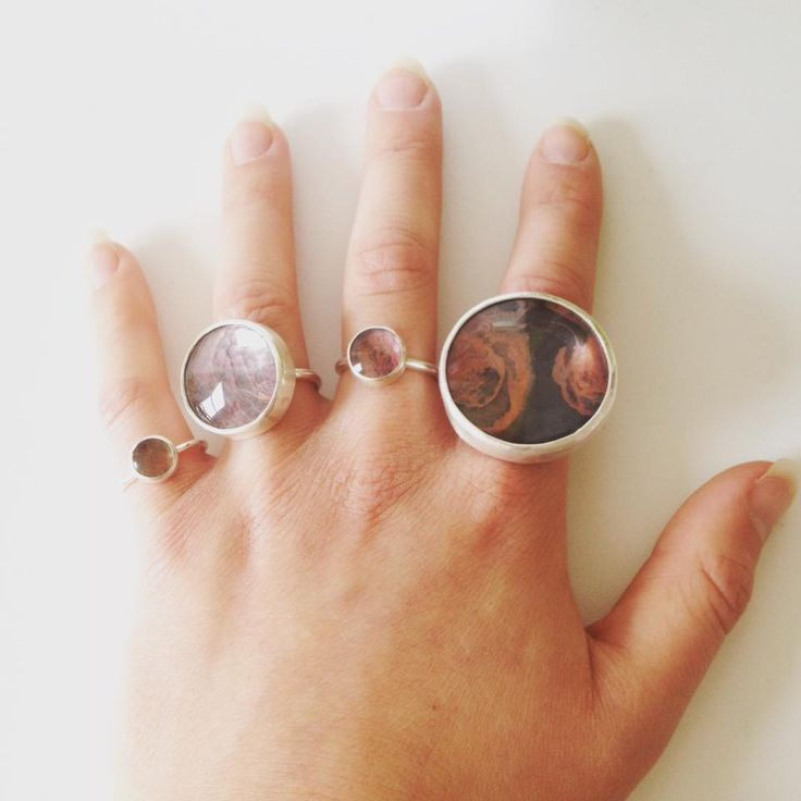 Four different sizes of copper glass rings by Rosita Bailey-Rosse