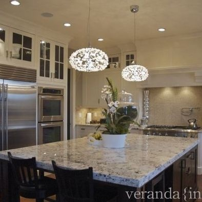 Glass pendant lighting over a kitchen island doesnt have to be country