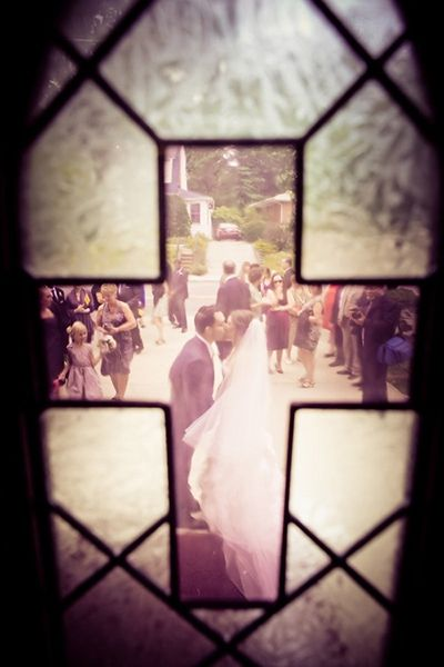 Through a Stained Glass Window - not sure if it's possible at the church, but maybe? Cool idea for sure anyhow