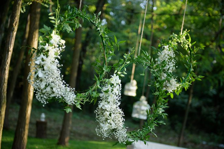 Fairy tale wedding outside decor with hanging flowers