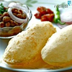 Authentic Punjabi Food at its best! A piping hot plate of Chhola Bhatura is sure to get your stomach growling. #india #food #punjab ##cholebathure #yum #yummy #food #foodie #cuisine #meal #taste #tasty