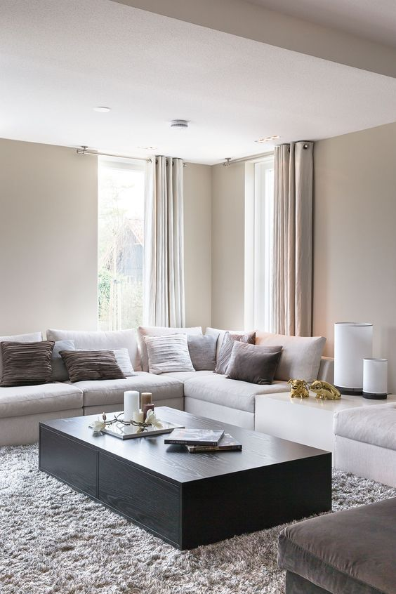 clean modern living room with light taupe walls and curtains