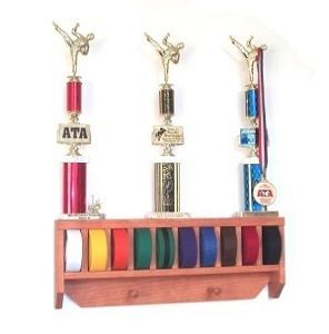 Roll and Stow Martial Arts Belt Holder - Holds up to 10 belts. No assembly required. Features a top shelf, perfect for those competition trophies or photos. Features include two pegs, ideal for hanging medals, or your uniform! Even add a personalized name. Learn More: http://www.karatesupply.com/Roll-and-Stow-Martial-Arts-Belt-Holder_p_1906.html #martialartsgifts #karatebeltholder #karatebeltracks