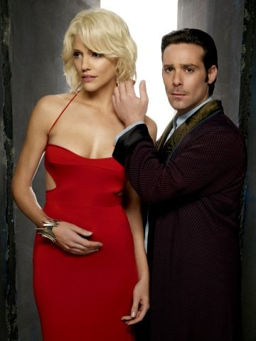 James Callis and Tricia Helfer as Gaius Baltar & Number Six in Galactica.