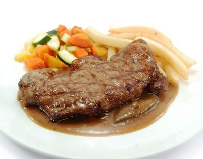 SIRLOIN STEAK, available in local, Aust. or Wagyu beef. Served with mushroom sauce, regular vegetables & french fries.