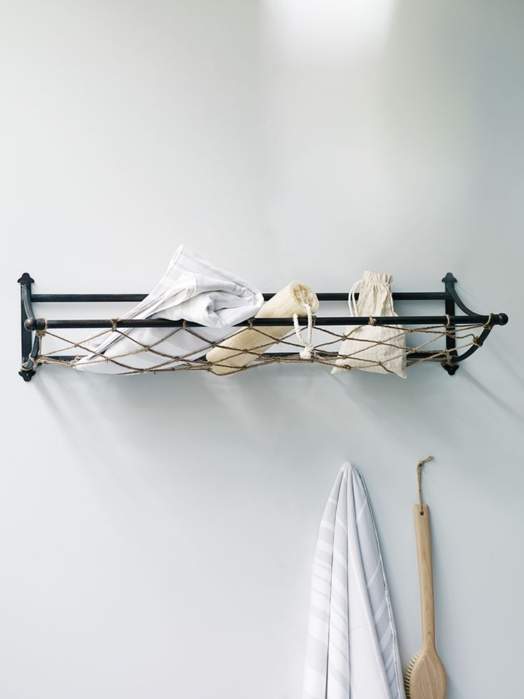 Inspired by old-fashioned train luggage racks, our handy station wall storage has an industrial metal finish with a simple rope basket. Use in the hallway for holding your hats, gloves and scarves or add to your bathroom for a vintage industrial twist.