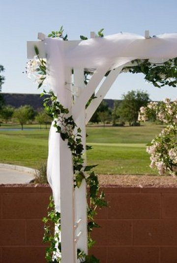 Outdoor Wedding Arch; Photograph  of weddings - see bride bouqet designs, decorating tables, lighted reception halls, floral supplies, church decor & floral arranging lessons.