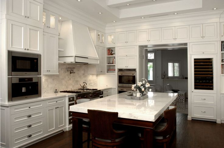 this custom white kitchen features handcrafted woodwork