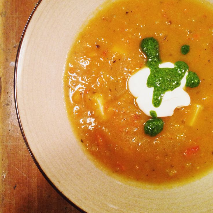 Butternut squash & sweet potato soup with a chimichurri and sour cream garnish.