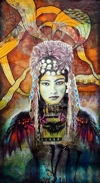 Il me semble qu'il s'agit d'une photo très célèbre d'une jeune femme berbère du Maroc, peut-être par Jean BESANCENOT En tout cas elle est joliment détournée  ♥ Wings of Intuition