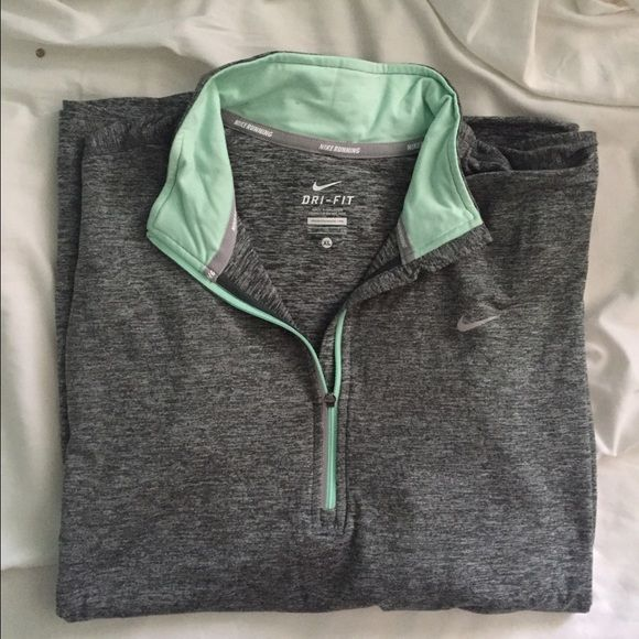 Nike Long Sleeve Grey Dry Fit Longsleeve Half Zip Grey and aqua womens dri fit half zip brand new from Nike never worn. No trades! Nike Tops Tees - Long Sleeve