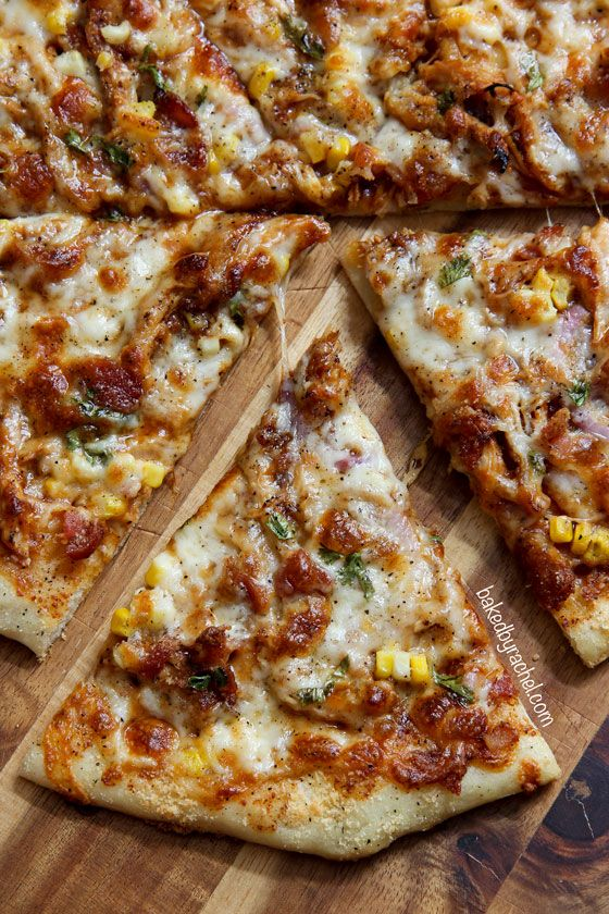 Homemade thin crust barbecue chicken pizza with crispy bacon, fresh corn and onions. Recipe from @bakedbyrachel