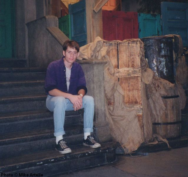 Sitting on the steps at 123 Sesame Street during my visit to the set in 1995. I got to look inside Oscar trash can!