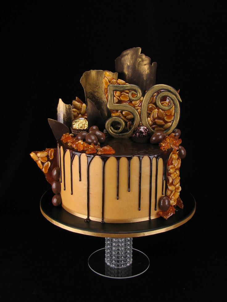 I really enjoyed making this cake, especially the peanut brittle...so yummy. This is a chocolate mudcake with salted caramel buttercream and a dark chocolate salted caramel ganache drip. On top are scorched almonds, ferreros, choc shards and peanut brittle shards with a big fondant 50.