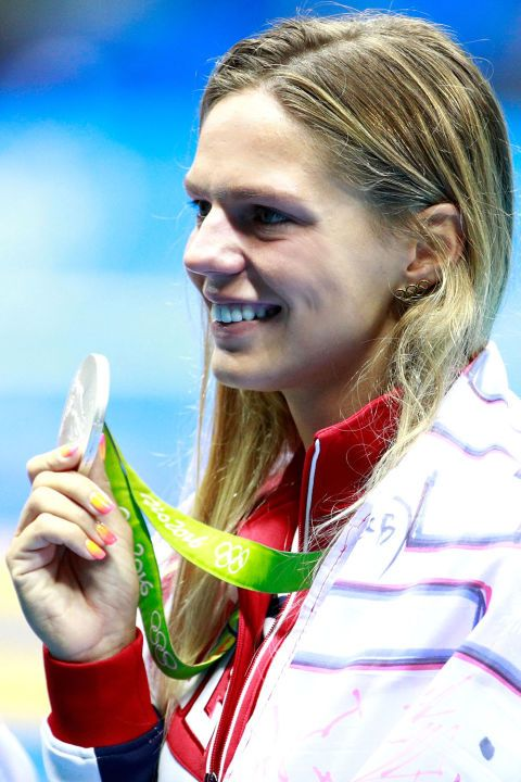 Best Of Olympic Beauty: Julia Efimova; The Russian swimmer and silver medalist may have gotten booed in the pool as a result of doping rumors; her ombre yellow to pink nails were still on point.
