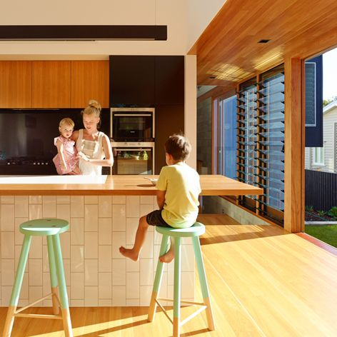 Like how this kitchen opens up to the deck and use of timber.