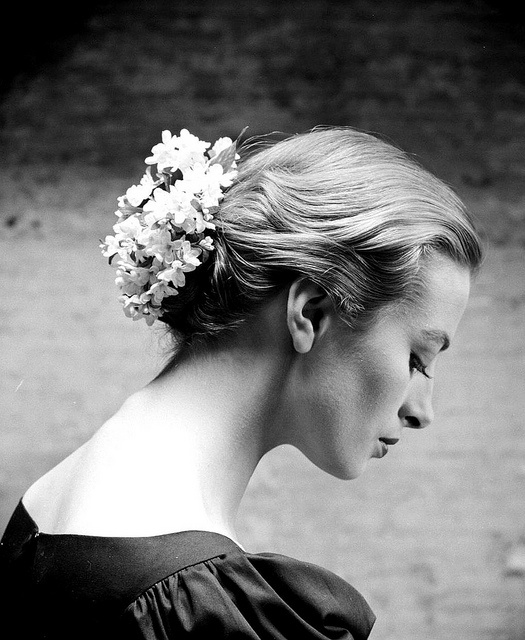 Capucine wearing flowered hair ornament as chignon, photo by Yale Joel, 1950s