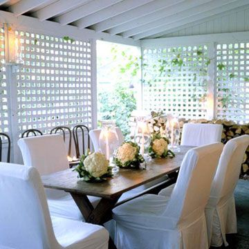 Dress the Porch  Lattice panels enclose this outdoor dining area and provide a sense of intimacy. Folding chairs slipcovered in white turn the porch into an elegant setting for a dinner party. Three cauliflower heads march down the wood tabletop for an unexpected centerpiece.