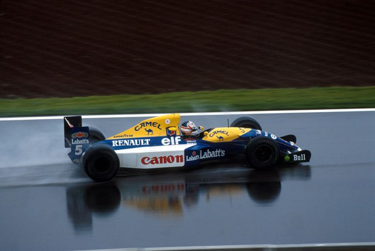 Nigel Mansell winning in the Williams FW14B, on a wet Barcelona track at the 1992 Spanish GP