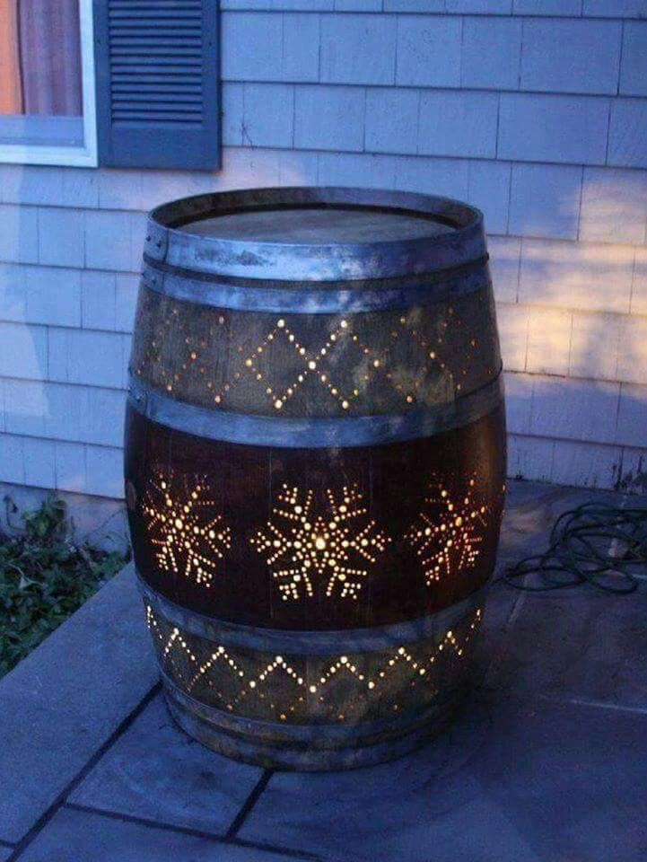 Use a drill to turn an old wine barrel into a beautiful porch light