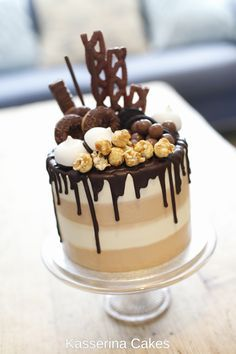 Chocolate and caramel candy cake by Kasserina Cakes in Sussex. With salted caramel, Nutella, curlywurly, Green and Black's, Twix, Mikado, caramel popcorn, chocolate Oreos, chcolate donuts, meringue, Maltesers, chocolate fudge cake, caramel frosting and vanilla bean frosting. YUM!