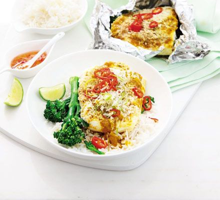 Steam sustainable fish like tilapia in foil parcels with curry paste, coconut and lime then serve with rice for a healthy supper