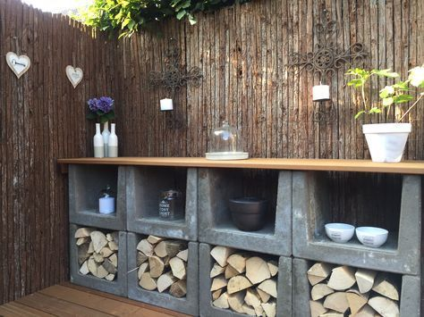# outdoor kitchen made from # u elements and finished with # tree bark mats