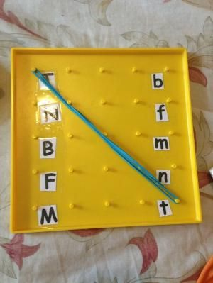 Abc center: matching uppercase and lower case letters.  Peg board, elastics, print out of corresponding letters. Focus: Matching upper and lowercase letters.