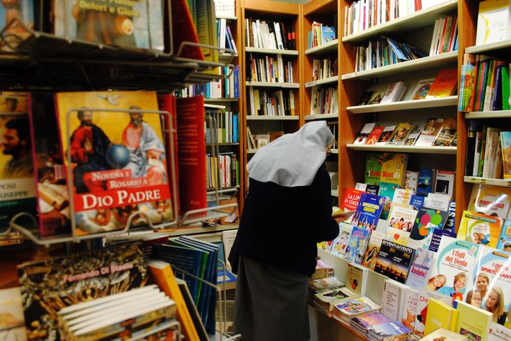 A noun looking for a book in one of the biggest religious themed bookshops in Rome, SAN PAOLO