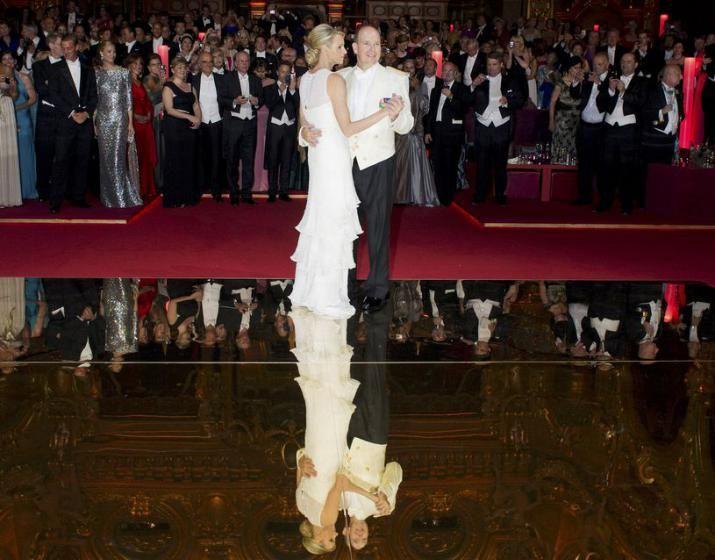 Monaco's Prince Albert II opens the ball with Princess Charlene at the Prince's Palace.