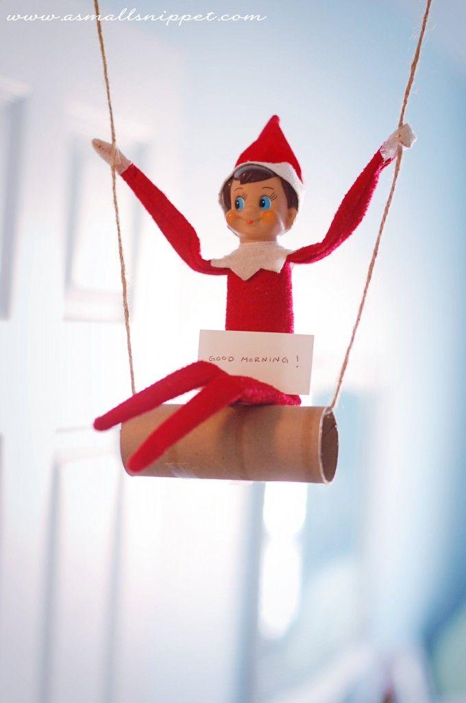 "Swinging elf w/ ""Good Morning"" sign"