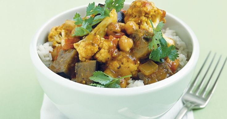 This vegetarian curry is a veritable Indian feast. Serve it with rice and coriander for a complete midweek meal.
