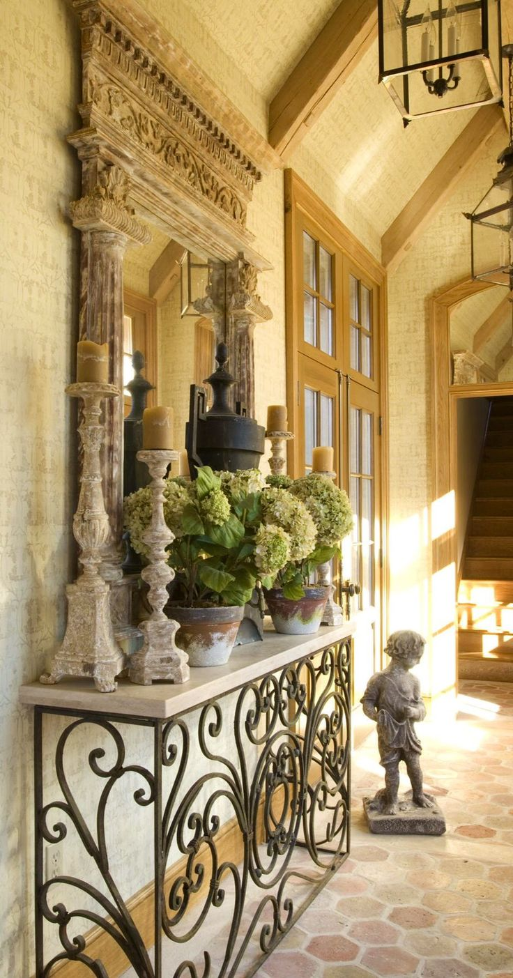 Beautiful entry with iron console, mirror, and accessories