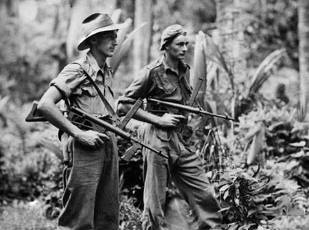Australian Privates Leon Ravet of Parramatta and Bernard Kentwell on patrol with Owen Machine Carbines New Britain. 4 April 1945. Photo: AWM 018320 Reg J. Edwards.