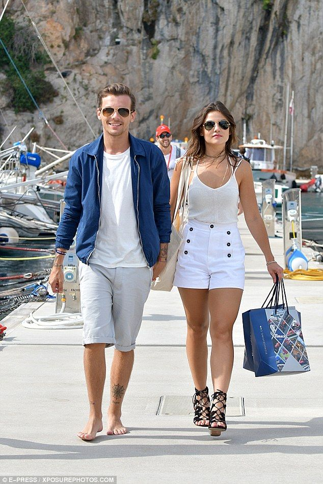 Loved up: Louis Tomlinson, 24, and his girlfriend Danielle Campbell, 21, certainly looked ...