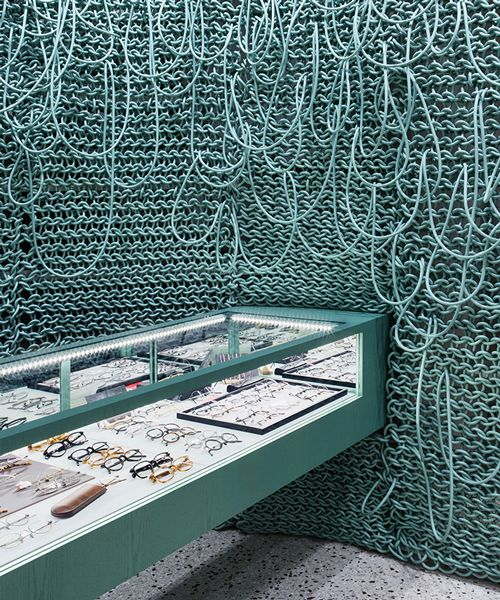 wall of knitted wires seen inside eyeglass store in seoul by wallga + WGNB