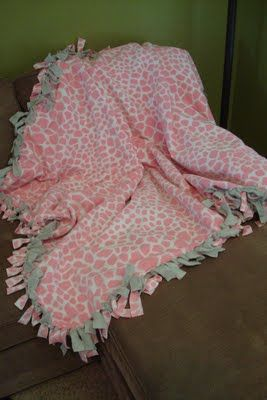 Fleece Tie Blanket Tutorial. This is such an easy blanket to make. I have a few laying around my house.
