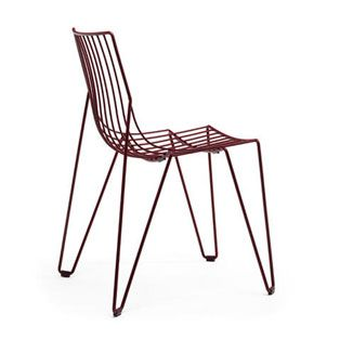 An elegant, stackable chair made solely from steel wire, The Tio Chair is suitable for indoor and outdoor use because of its transparency and clarity of design.