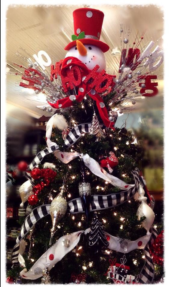 Our red, black, white and silver tree with a snowman tree topper. Show stopper!