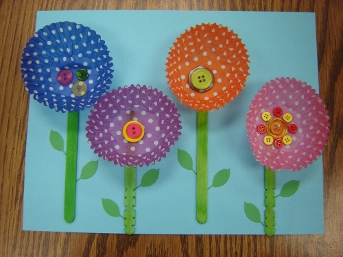 Flowers with cupcake cases. Could use painted ones with crumpled tissue for pollen or buttons.