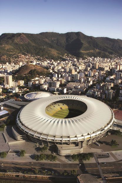 Estádio do Maracanã, Rio de Janeiro, Brazil. Architect: Daniel H. Fernandes. Category: Retrofit. Ingenious reworking of structure has allowed the addition of a spectacular stressed-skin roof which transforms a 1950s icon for use in the next football World Cup.