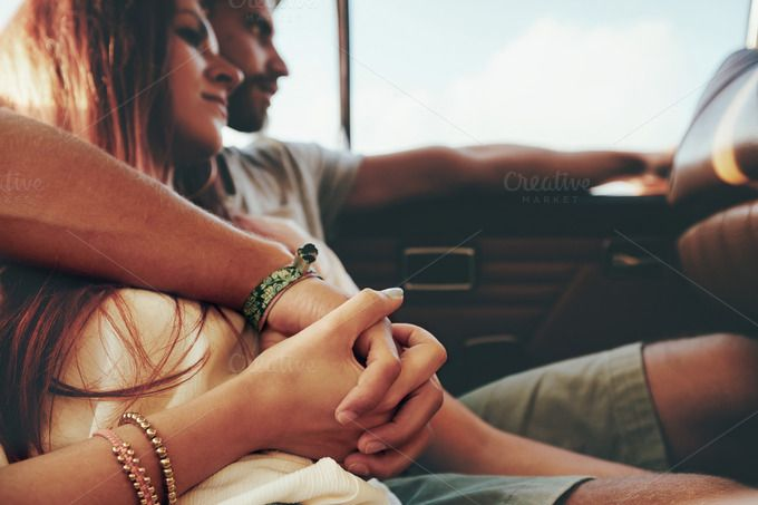 Affectionate young couple on a road by Jacob Lund Photography on Creative Market
